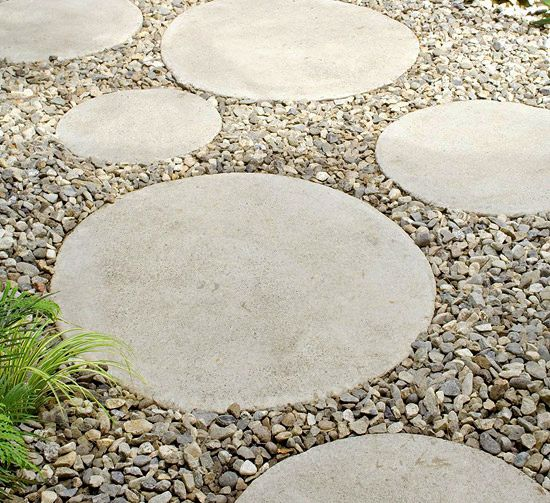 use the rest of the cement to make about 25 circular stepping stones. Make some with open circles in them so grass grows thru it. Place on north side of house.