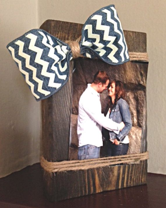 This is truly a one of a kind photo holder that is all natural wood and has been hand stained and distressed. The frame measures 8 x5 1/2 x 1 inches. The bow is adjustable to showcase the perfect photo. The twine and chevron bow complete this shabby chic, country photo holder. It will hold a 4x6 or smaller picture and can be displayed either landscape or portrait. Ideal gift for any special occasion! Thanks for shopping