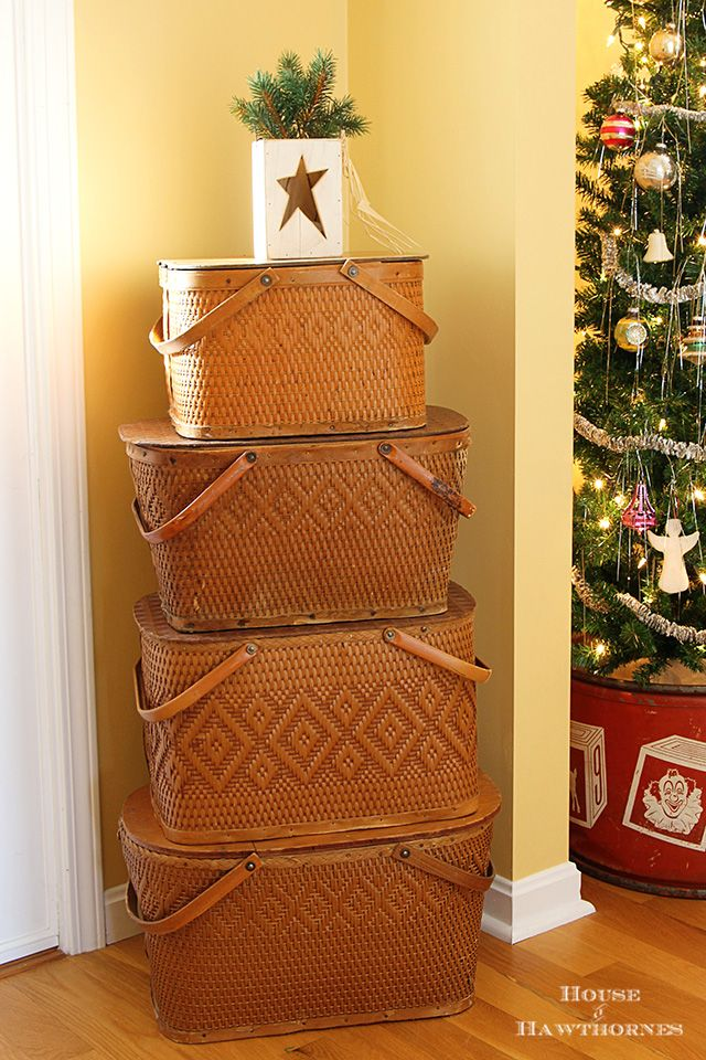Vintage Redman picnic baskets stacked to make a fun Christmas tree