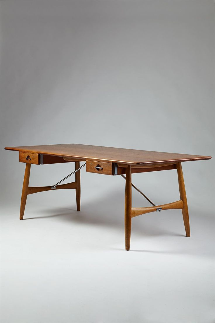 Wegner, Hans Desk designed by Hans Wegner for Johannes Hansen, Denmark. 1952. - Solid teak, oak and chromed steel.