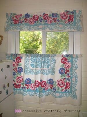 vintage tablecloth turned curtains...did this in my kitchen and I love it.  Great way to use a table cloth with some spots you can't get out.