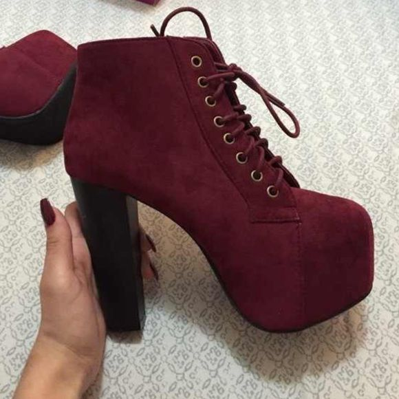 Pumps Burgandy pumps with burgundy laces up to the ankle with a big platform. Heels about 5-6 inches tall and black. Shoes Heels