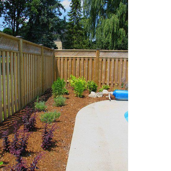 Freshly installed garden surrounding a pool