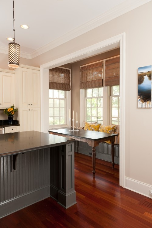 The walls are Urban Putty from Sherwin Williams and the island is Benjamin Moore Kendall Charcoal.
