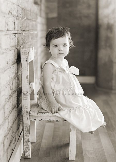 omg...this picture made me think...if I ever have a daughter, I must take a black and white photo of her like the one of Gramma  Betty when she was 1 year old sitting on that little chair. So cute!