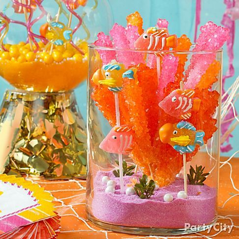 "Create an adorable, edible aquarium with rock candy ""coral"" and fruit-flavored jelly candy fish."