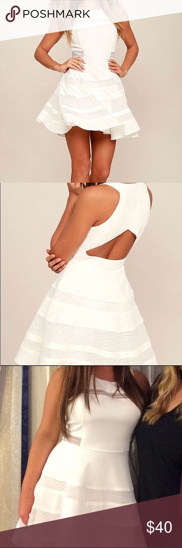Beautiful White Dress Wore this once for my bachelorette party! It was a success! Sweet, playful, and totally charming, the Play Nice Ivory Skater Dress will earn you admirers left and right! Ivory woven poly is silky soft and light throughout the fitted bodice with rounded neckline, princess seams, and sexy sheer mesh panels. The skater skirt completes this party-ready ensemble with more alluring bands of mesh. Circular cutout at back. Hidden side zipper with clasp. Lulu's Dresses
