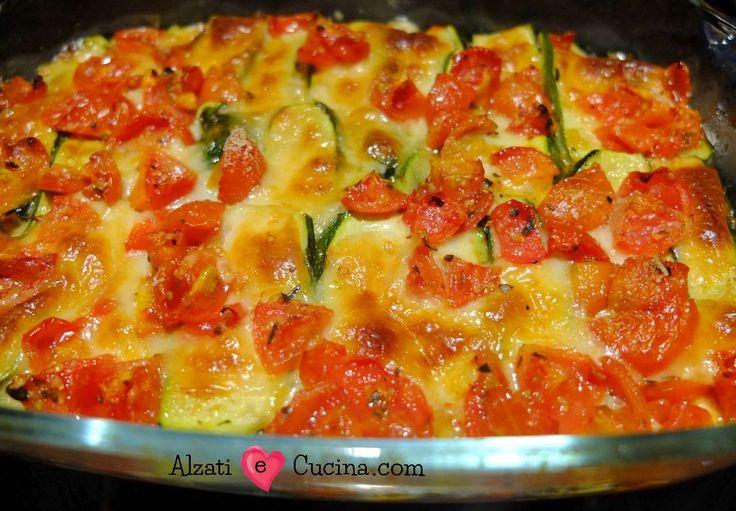 Parmigiana di zucchine con pomodori e scamorza