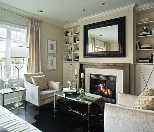 Suzie: Kelly Deck Design - Chic living room design with green-ish beige walls paint color, ...: Ideas, Interior, Living Rooms, Deck Design, Livingroom, Cowhide Rugs, Family Room, Fireplace