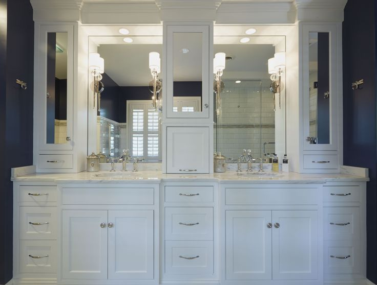 Double white vanities with mirrored upper cabinets and