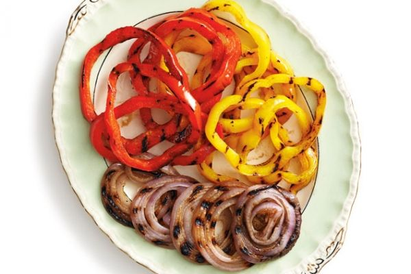 Every barbecued meal needs grilled peppers and onions. We show you how! Photo by Jeff Coulson.