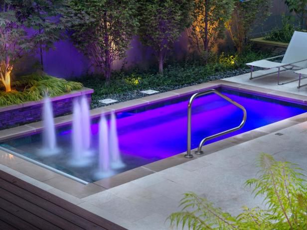 An evocative purple lighting scheme accents the unique qualities of this plunge poo l in a · lap poolsswimming poolssmall