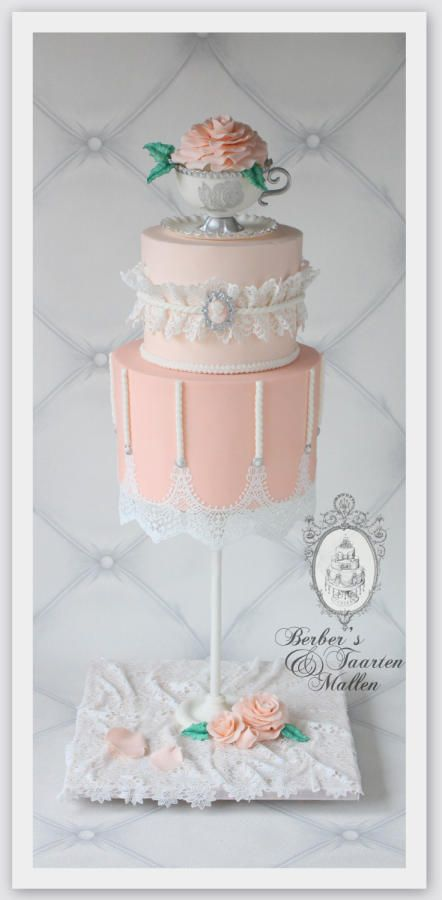 Pink and lace gravity defying cake by Berber's Taarten en Mallen