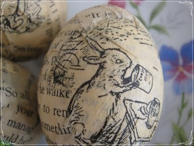 Up-cycle children's book pages that have pen and ink drawings onto eggs with ModPodge.