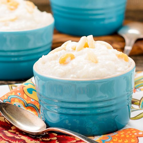 A recipe for Slow-Cooker Kheer aka Indian Rice Pudding. It is a rich and creamy dessert made with milk, rice, almonds, raisins, and flavored with cardamom.