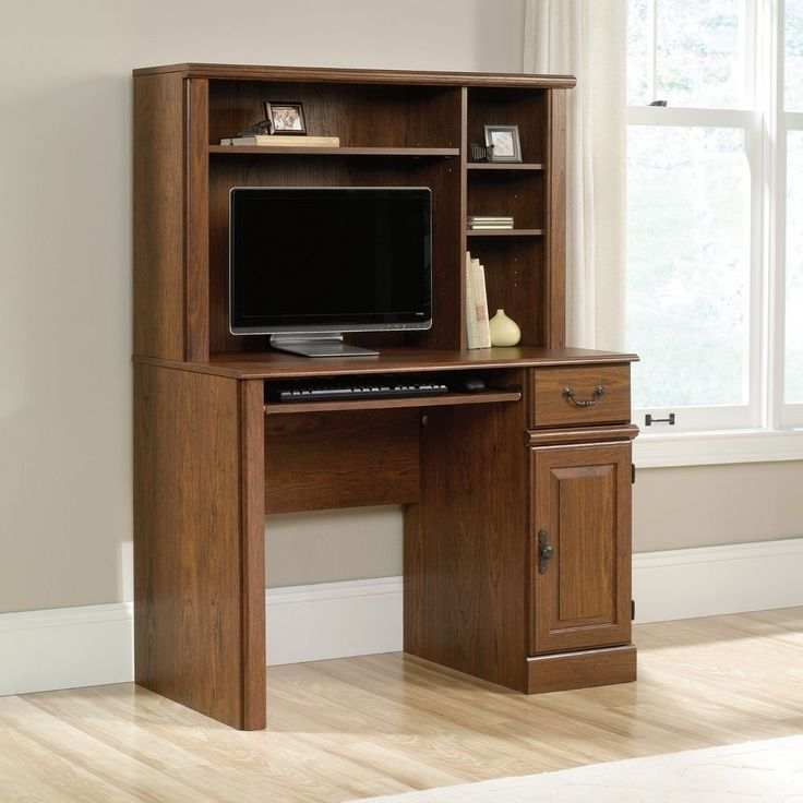 A computer desk with hutch makes a small computer desk more spacious. Home office desk features include:Slide-out keyboard/mouse shelf with metal runners and safety stops.Drawer features patented T-lock assembly system.Storage area behind raised panel door holds vertical CPU tower.Hutch features three adjustable shelves.Milled Cherry finish. | eBay!