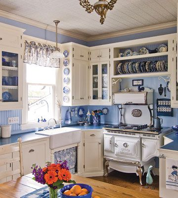 Love the blue and white!!    Vintage charm. True to its roots, the Kramers' Victorian-style kitchen is full of authentic details, like seeded glass and pendant lights. A modern dishwasher hides behind a cabinet beside the sink.  http://www.countrywomanmagazine.com/kitchen-remodel-for-victorian-house/
