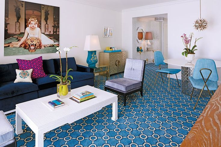 Jonathan Adler Gives the Eau Palm Beach Resort & Spa a Sunny Update.   Butterfield sleeper sofa, Preston cocktail table, Nixon slipper chair, Maxime dining chair, mini Sputnik chandelier, Bel Air Lucite scoop vase, and Talitha console.