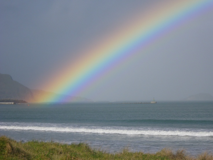 A wonderful reason to surf in the rain......Epic Rainbow!