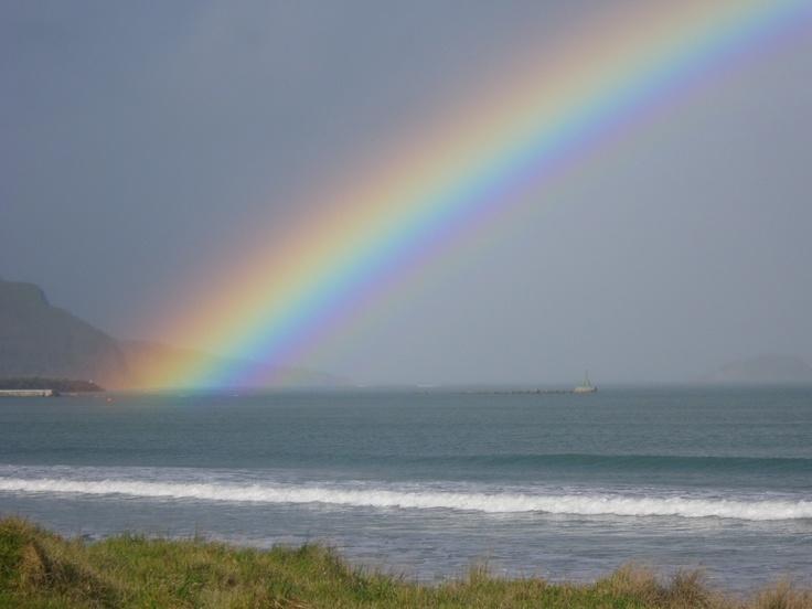 A wonderful reason to surf in the rain......Epic Rainbow!