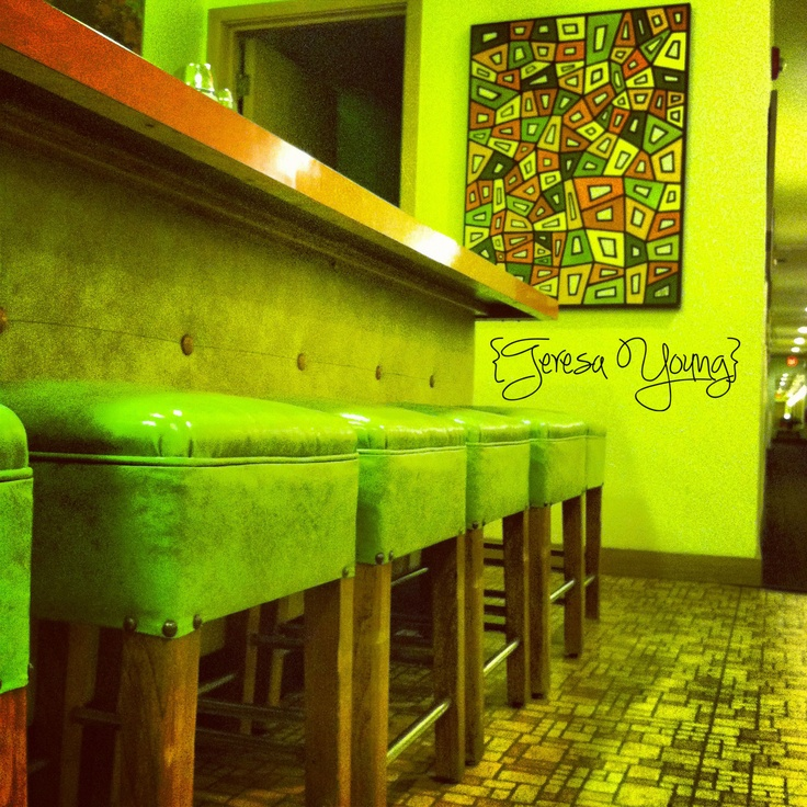 diner counter and stools from 1953, with a beautiful painting by Barbara  MacDonald
