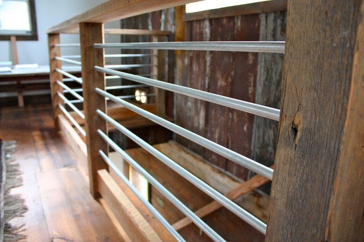 Reclaimed wood railing with recycled electrical conduit.