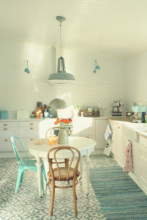 ight kitchen with old tile floor and white with turquoise color scheme