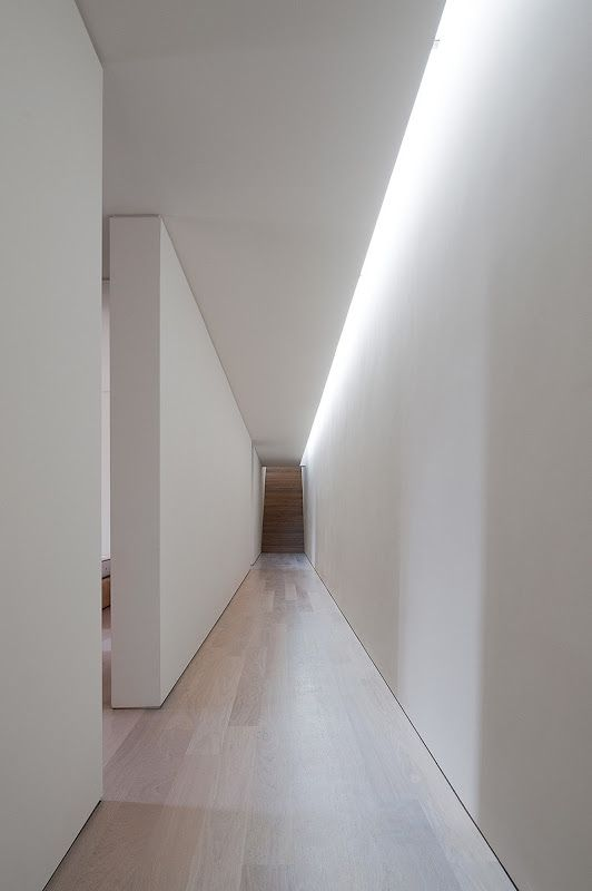 Light on one side of the gallery hallway from skylight. Casa Melides. Portugal. Pedro Reis Architect