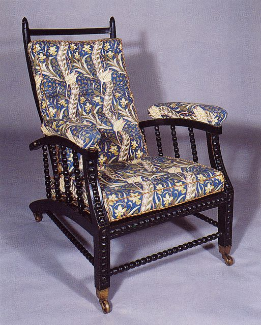 Morris Chair by William Morris & Co. in blue upholstery Taken from William Morris: Redesigning the World by John Burdick, p. 49