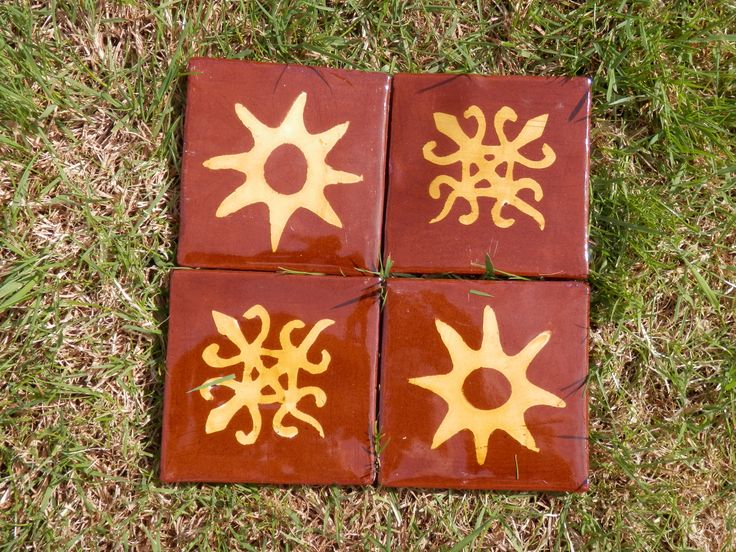 Adinkra symbols (Ghana): Nsoromma (child of the heavens - symbol of guardianship) and Funtunfunefu (siamese crocodiles-symbol of unity). Inlaid ties by Tanglebank tiles.