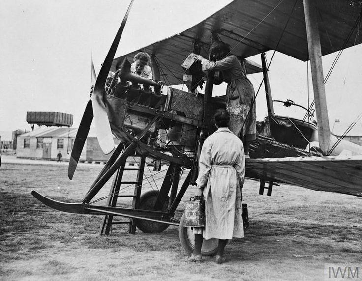 THE WOMEN'S ROYAL AIR FORCE 1914 - 1918    Air mechanics of the Women's Royal Air Force (WRAF) refuelling a modified Royal Aircraft Factory B.E.2 biplane.