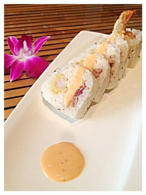 $O$UMI: crab mix, spicy tuna, shrimp tempura & red onion rolled with sesame soy paper, drizzled with spicy $o$umi aioli