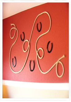 Cute wall decor for the hallway in a facility. Instead of real horseshoes use the light weight plastic ones that come in kids horseshoe set or make them out of styrofoam them paint with a metal tint paint. The light weight version will not hurt the walls.