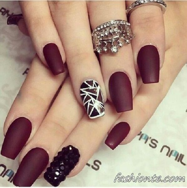 White, black and maroon nail art design. You can never go wrong with this ensemble as it represents fierce and strength from the way that the color blend with each other alone.