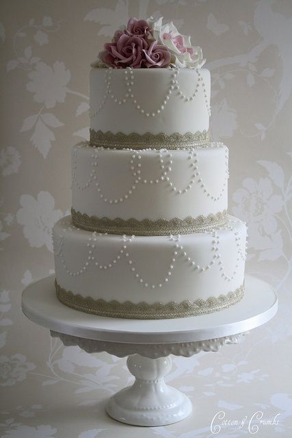 This is it....this is th cake but with lace on the bottom of each layer with dark and light purple  flowers on top!!!!!!!!!