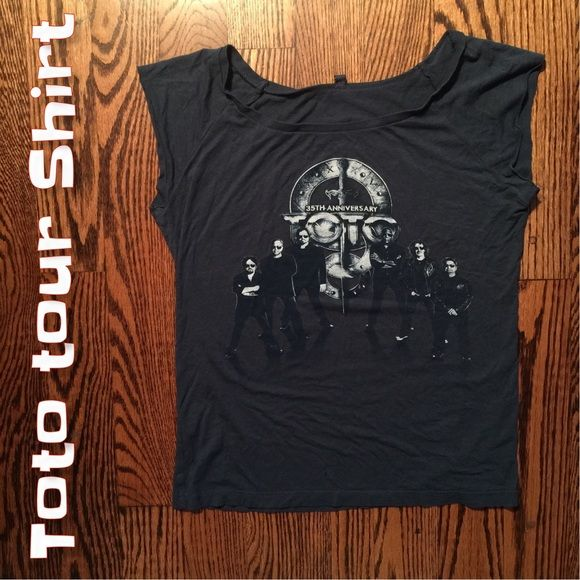 "✅Toto Tour shirt I have tons of rock shirts and Toto swag in particular. I'm listing this one because it's the silkiest material and the cut is really flattering and because I have it in a Medium which fits me better. Never worn this one/this size. Great dusky blue colour. 17"" armpit to armpit. 21"" length. Tops"