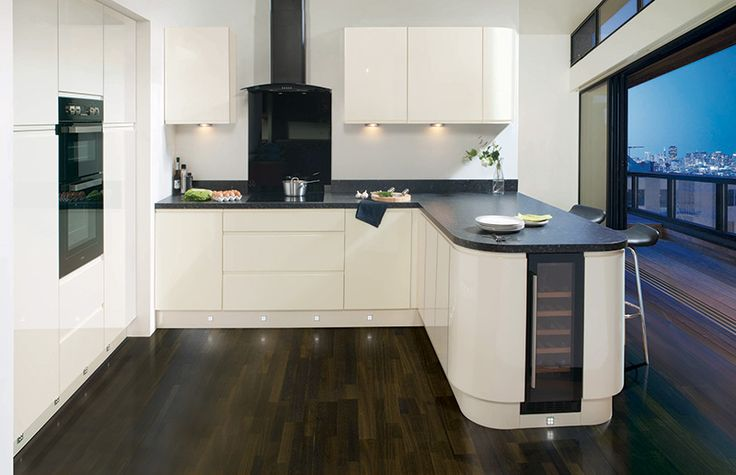 Cut Price Kitchens Cream Sculptured Gloss Kitchen. Handless and contemporary. Gloss look that's easy to maintain. Cute curve options to create a rounded look. A fast growing favourite in the UK. Comprising of 18mm thick carcases, soft-close hinges and benefits from 330mm deep wall cabinets. www.cutpricekitchens.co.uk
