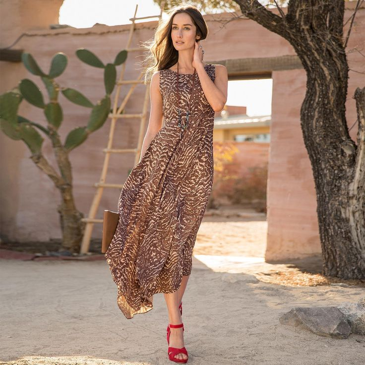 """SALMA DRESS--With its sinuous, organic print, our patterned rayon maxi dress will put a swing in your step, thanks to a flattering, full sweep handkerchief hem skirt and shaped bodice. Rayon. Machine wash. Imported. Exclusive. Sizes 2 to 16. Approx. 47""""L."""