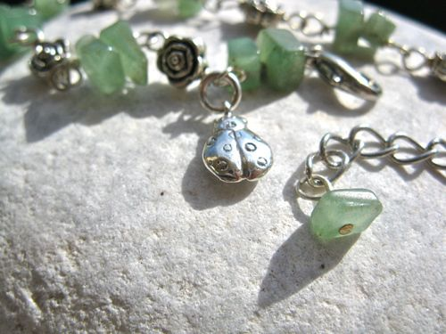Aventurine lucky charm bracelet with silver ladybird. . . an inspirational bracelet to help dreams come true. You could help friends and loved-ones de-stress from life's problems and strive for success with this pretty Aventurine lucky charm bracelet. Made of lustrous sea-green-coloured Aventurine chips interspersed with little metal flower beads, it features a sterling-silver lucky ladybird charm for added good fortune