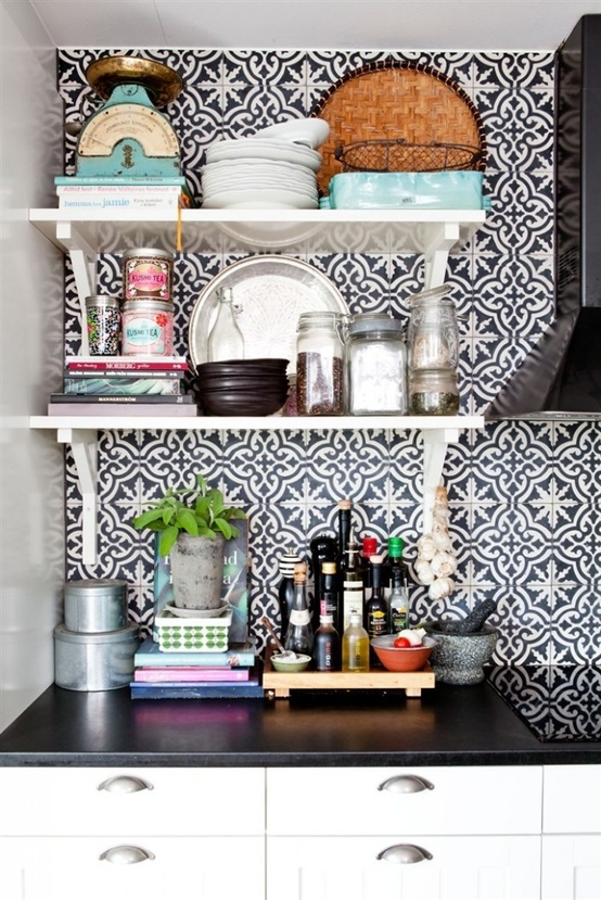eclectic details. wall paper behind shelves for texture