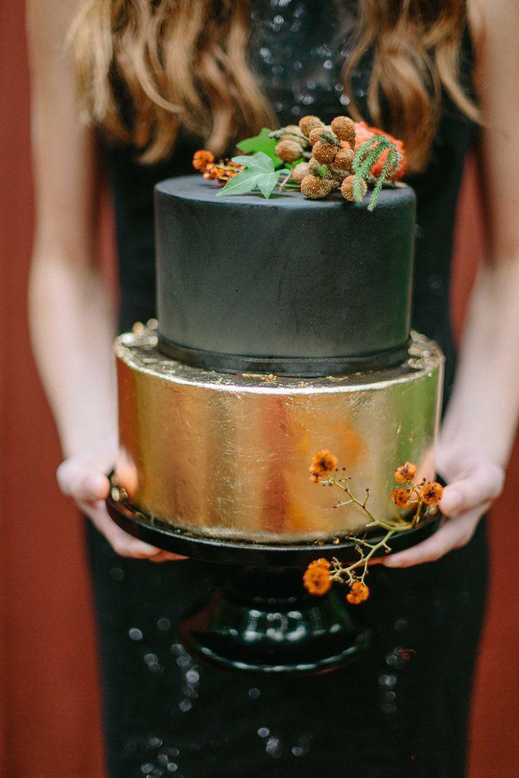 gold and black wedding cakes - photo by INGAVEDYANweddings and fashion http://ruffledblog.com/moody-burgundy-and-gold-wedding-inspiration
