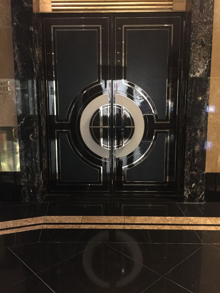 PHOTO ONE CROWN PLAZA LOBBY: These are marble doors found in the crown plaza lobby. The use of the material marble creates a sophistication and expensive interior. These materials work well in this environment to reflect and tie in well with crowns luxurious image.