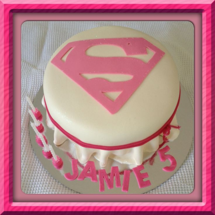 Moist Vanilla buttercake.  Simple clean white skirted marshmallow fondant. Simply Super SuperGirl covered with super edible holographic glitter. Just add a sparkler and you have a super cake.