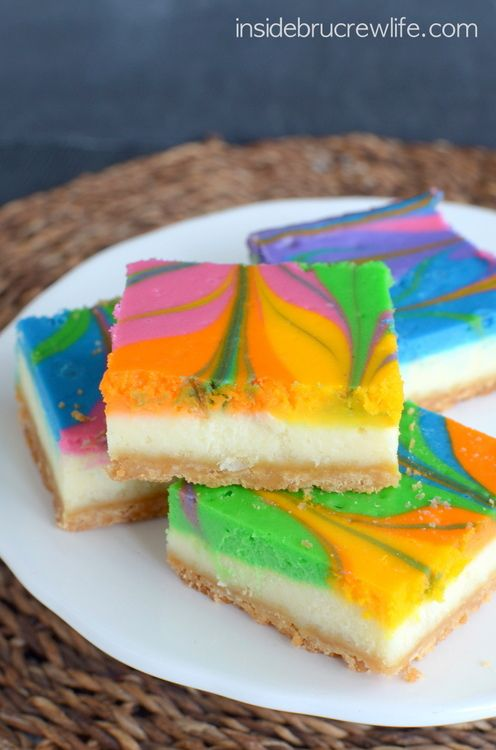 Rainbow Vanilla Cheesecake Bars - vanilla cheesecake with a fun rainbow swirl.  Fun, festive, and perfectly delicious!
