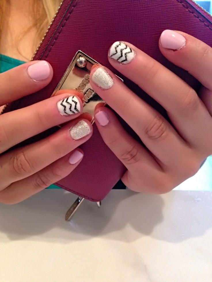 The IT GIRL TREND . Fashionable fun and ready to hit the beach , back yard bbq , or nightlife . Blend sparkles and zig zags for flawless fun. Nails by Deanna at Mia Spa .