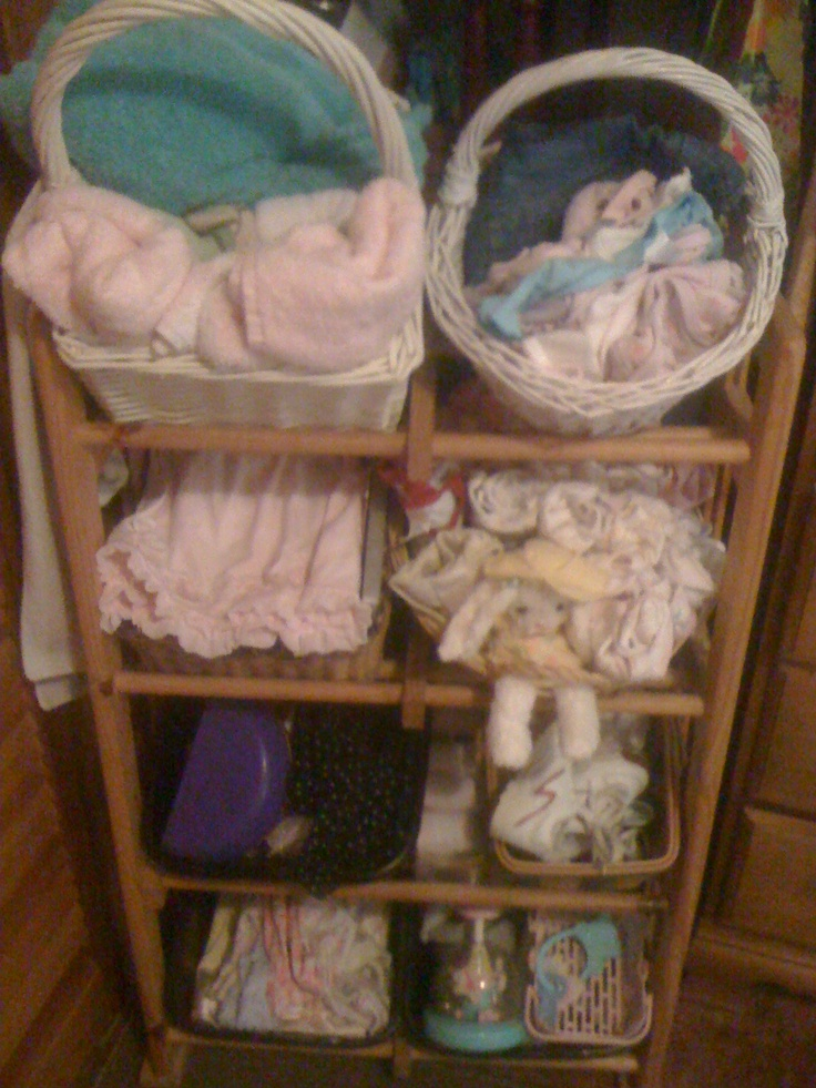 Re Purposed CD Rack Stacked With Baskets Of Baby Things. Great Storage Idea.
