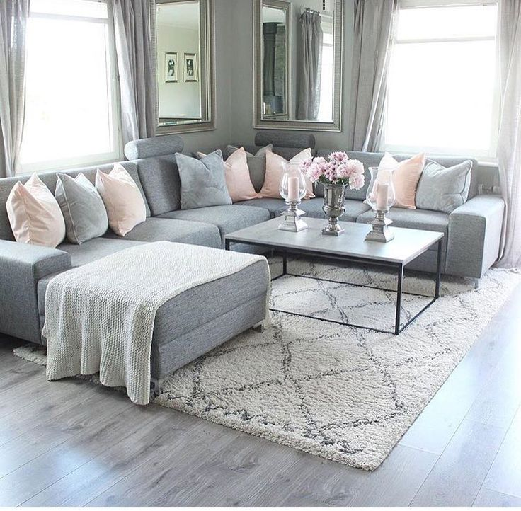 Grey couch – black and white coffee table – basket…