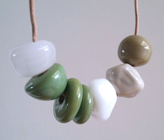 cool green and white lampwork beads on natural leather #synergyglassart