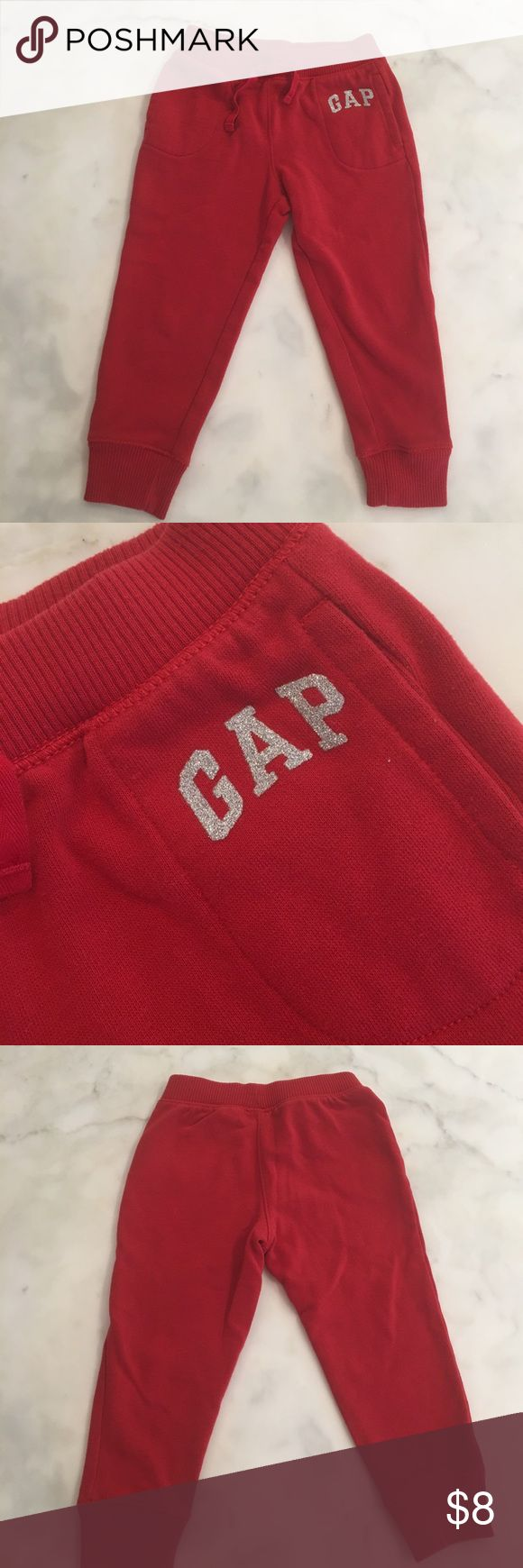 BabyGap red Joggers with glitter logo. Sz 3 BabyGap bright red Joggers with silver sparkly logo on pocket. These are soooo soft inside. Sz 3. Great condition. babygap Bottoms Sweatpants & Joggers