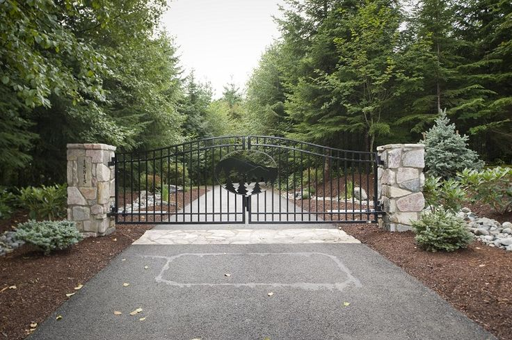 Double swing gate with custom laser cut tree design